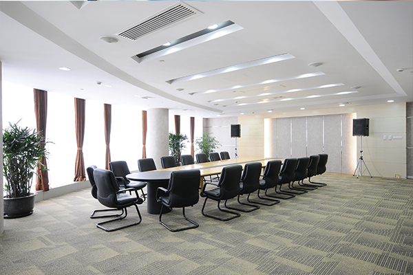An image showing a clean stylish modern conference room